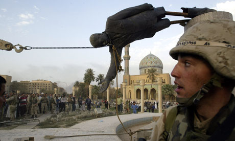 A-statue-of-Saddam-Hussein-is-pulled-down-in-Baghdad-on-9-April-2003.-Photograph-Jerome-Delay-AP